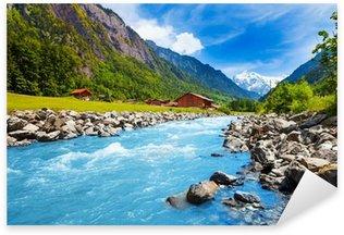Sticker Pixerstick Paysage suisse avec le courant de la rivière et des maisons