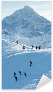 People on the snow-covered mountain peaks and rocky peaks. Sticker - Pixerstick