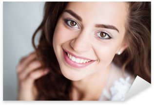 Portrait of smiling woman with perfect smile and white teeth looking at camera Pixerstick Sticker