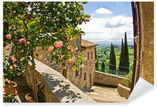 Roses at balcony in San Gimignano, Tuscany landscape background Sticker - Pixerstick
