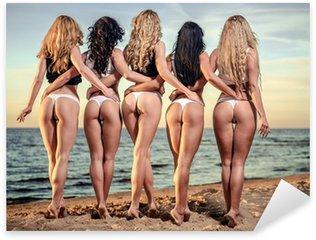 Sexy backs of five beautiful women in bikini on the beach Sticker - Pixerstick