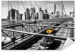 Taxi cab crossing the Brooklyn Bridge in New York Sticker - Pixerstick