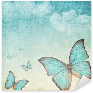 Pixerstick Sticker Vintage achtergrond met een blauwe vlinder