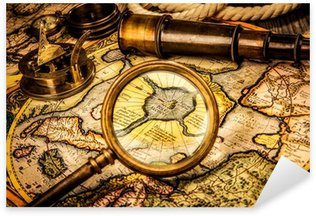 Sticker - Pixerstick Vintage magnifying glass lies on the ancient map of the North Po
