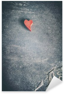 Vintage toned wooden red heart on grunge stone background, shallow depth of field, space for text. Sticker - Pixerstick