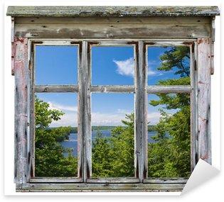 Sticker Pixerstick Vue panoramique vu à travers un cadre de fenêtre vieux