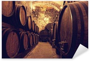 Sticker - Pixerstick Wooden barrels with wine in a wine vault, Italy