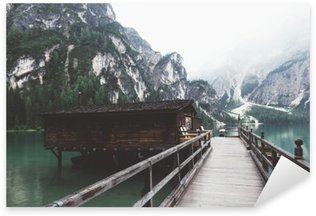 wooden jetty on Braies lake with mountains and trees Sticker - Pixerstick