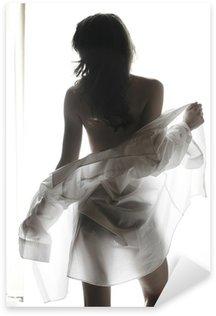 Young woman undressing Sticker - Pixerstick