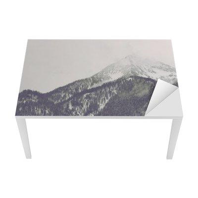 Clouds moving over distant mountain peak Table & Desk Veneer