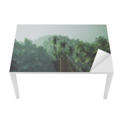 Rope bridge in misty jungle with palms. Backlit. Table & Desk Veneer