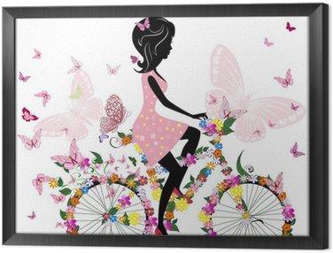 Tableau en Cadre Fille sur un vélo avec un papillons romantiques