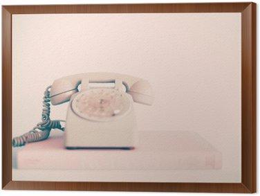 Tableau en Cadre Vintage téléphone rose sur les livres