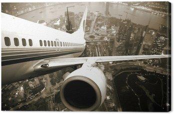 Tableau sur Toile Avion en plein décollage quittant la ville