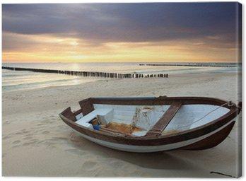 Tableau sur Toile Bateau sur la plage magnifique lever de soleil