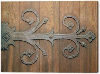 Tableau sur Toile Close-up d'une charnière de fer ornemental sur une vieille porte en bois