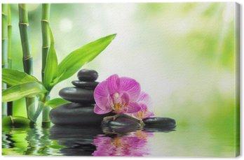 Tableau sur Toile Contexte spa - orchidées pierres noires et de bambou sur l'eau