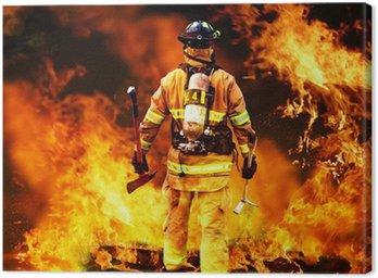 Tableau sur Toile Dans l'incendie, un pompier recherches pour d'éventuels survivants