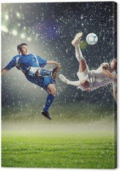 Tableau sur Toile Deux joueurs de football de frapper la balle