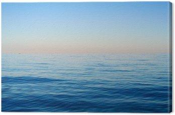 Tableau sur Toile Les vagues sur un fond de ciel bleu