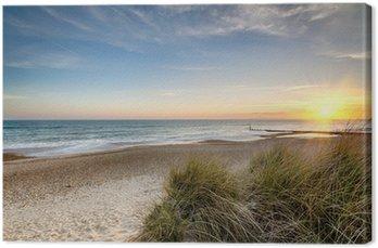 Tableau sur Toile Lever de soleil sur une plage déserte