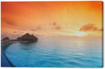 Tableau sur Toile Maisons maldivian sur le lever du soleil