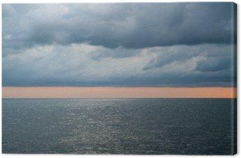 Tableau sur Toile Nuageux ciel orageux spectaculaire sur la mer