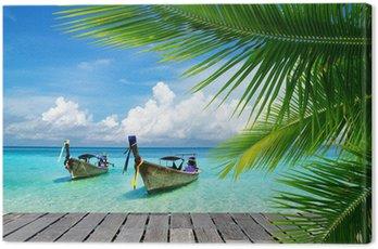 Tableau sur Toile Pont avec vue sur une mer tropicale