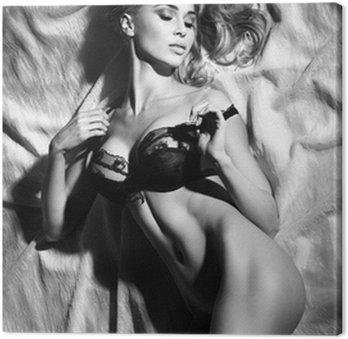 Tableau sur Toile Portrait de dame blonde sensuelle dormir dans pose sexy.