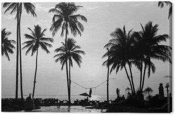 Tableau sur Toile Silhouettes de palmiers sur une plage tropicale, la photographie en noir et blanc.