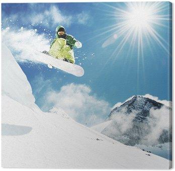 Tableau sur Toile Snowboarder au saut montagnes inhigh