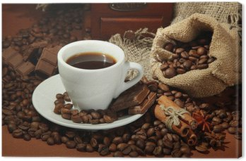 Tableau sur Toile Tasse de café et grains de café sur fond brun