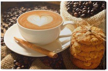 Tableau sur Toile Une tasse de café au lait avec des grains de café et des biscuits