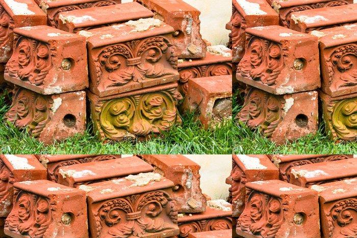 Tapeta Pixerstick Antique tvárnice naskládaných na trávě. - Jiné