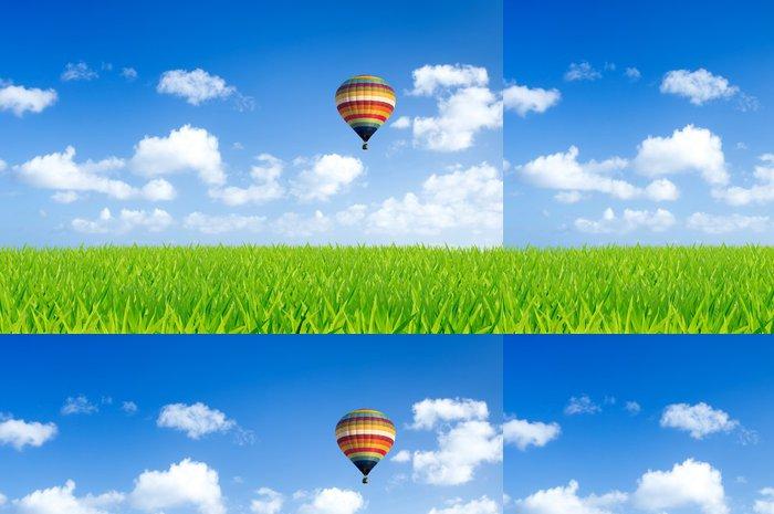 Tapeta Pixerstick Barevné horkovzdušný balón nad zelenými poli - Svoboda