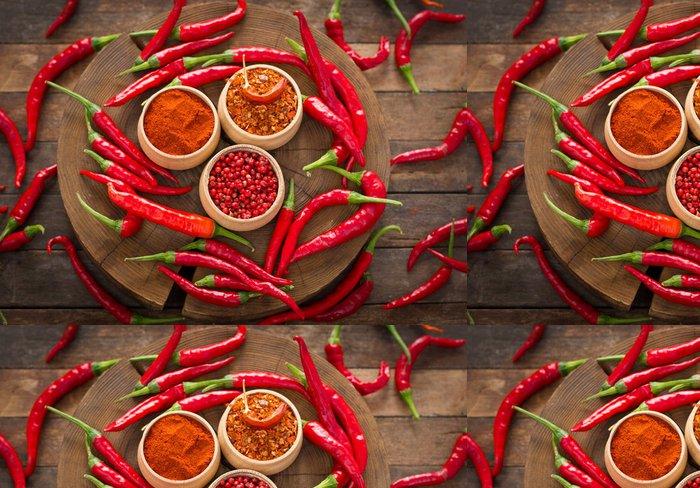 Tapeta Pixerstick Červené chilli papričky a koření na stole - Jídla