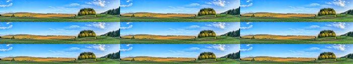 Tapeta Pixerstick Dlouhé panorama s malým lesem - Hory