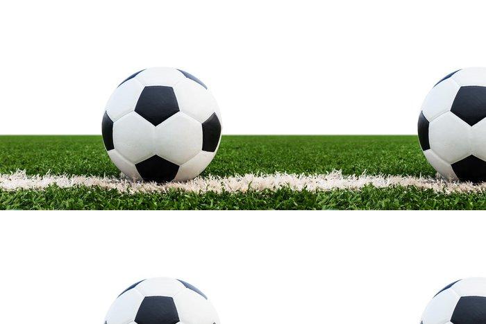 Tapeta Pixerstick Fotbalový míč na zelené trávě pole izolované - Týmové sporty