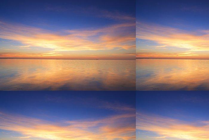 Tapeta Pixerstick Krásné červené západ slunce nad oceánem - Nebe