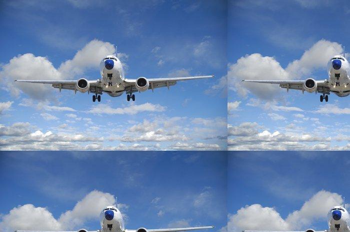 Tapeta Pixerstick Letecká doprava - Letadlo letí v modré nebe s mraky - Témata
