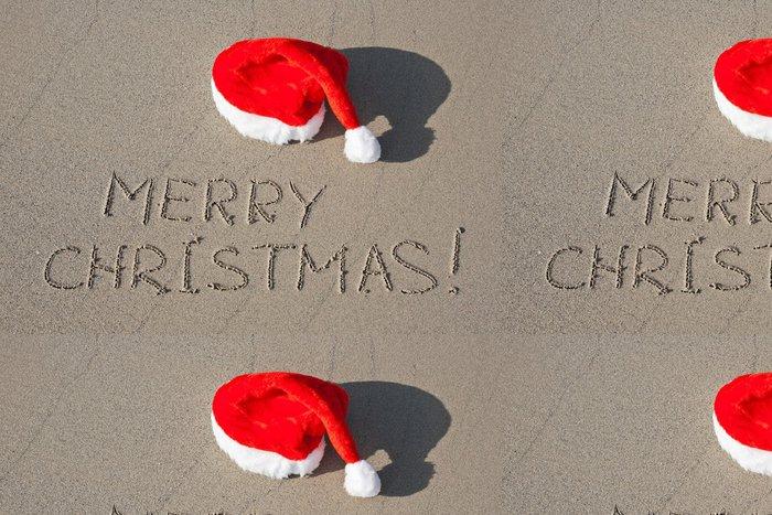 Tapeta Pixerstick Merry Christmas napsaný na písečné pláži v červeném klobouku Santa - Mezinárodní svátky