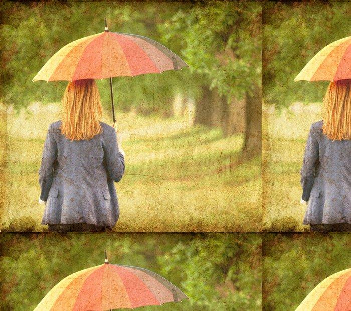 Tapeta Pixerstick Mladý módní dívka s deštníkem v jarní přírodě. - Témata