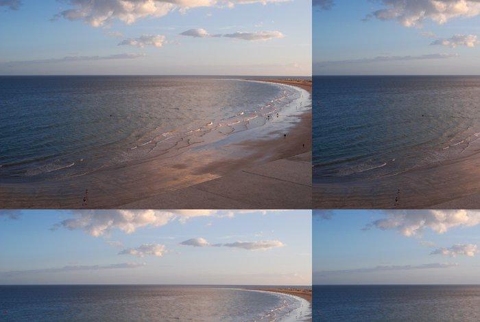 Tapeta Pixerstick Mořská proti západu slunce na obloze - Voda