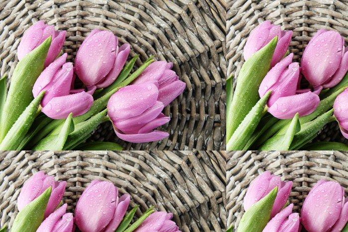 Tapeta Pixerstick Nádherná kytice z fialové tulipány na šedém pozadí proutí - Témata