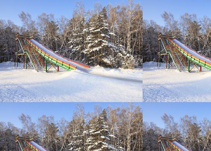 Tapeta Pixerstick Slide pokrytá ledem v zimě lese. - Prázdniny