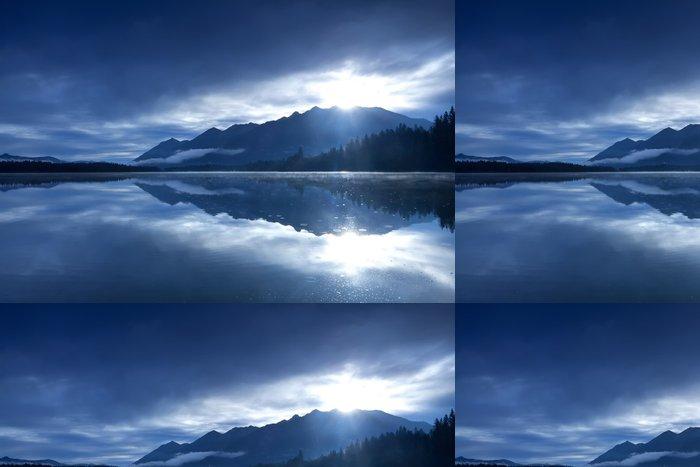 Tapeta Pixerstick Sluníčko přes hory a vysokohorské jezero - Hory