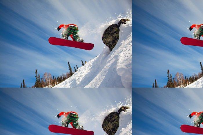 Tapeta Pixerstick Snowboardista skákání vzduchem s modrou oblohou v pozadí - Prázdniny