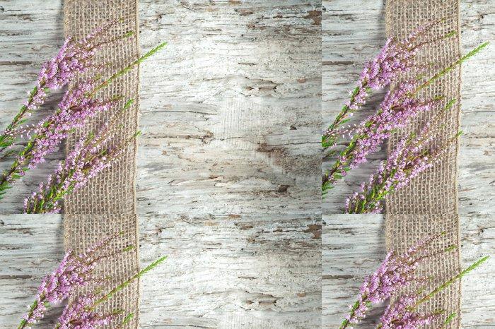 Tapeta Pixerstick Staré dřevěné pozadí s vřesem a vyhození stuhou - Vřes