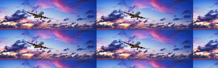 Tapeta Pixerstick Tryskové letadlo ve velkolepé západu slunce na obloze - Témata