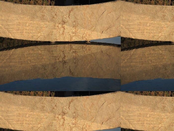 Tapeta Pixerstick Velký kámen odraz ve vodě jako pozadí - Struktury